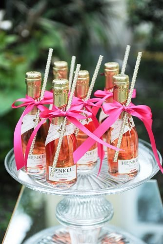 mini champagne bottles decor with ribbons
