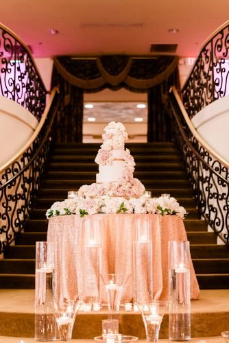 rose gold wedding decor candle near cake A.J. Dunlap Photography