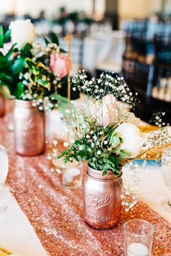 rose gold wedding decor table decor with jars Dirt Pearls and Curls Photography
