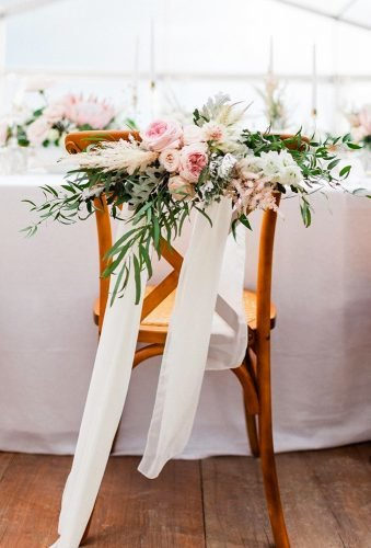 simply chic wedding flower decor ideas floral chair decor rorywylieweddings