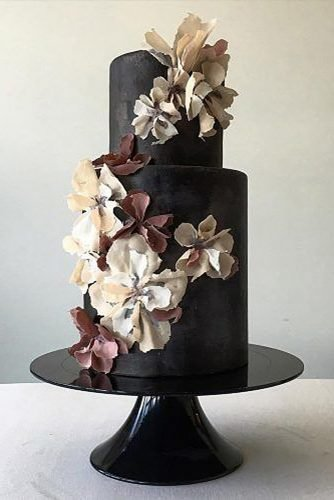 black and white wedding cakes black cake with flower