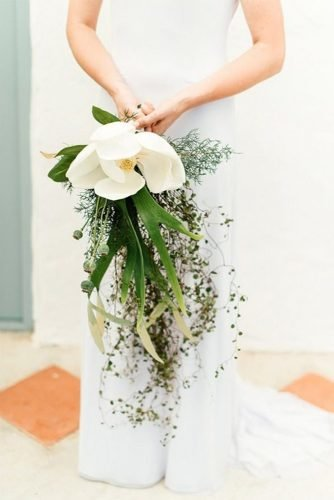 single bloom wedding bouquets greenery cascading with white magnolia leandri kers