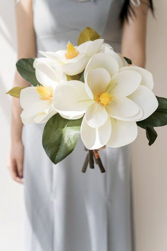 single bloom wedding bouquets white magnolias with leaves lingsmoment
