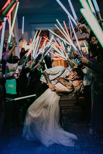 star wars wedding newlyweds exit with lightsabers