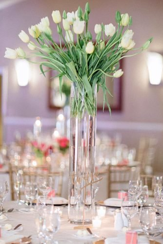 wedding centerpieces yellow tulips in glass tall vase hunterryanphoto