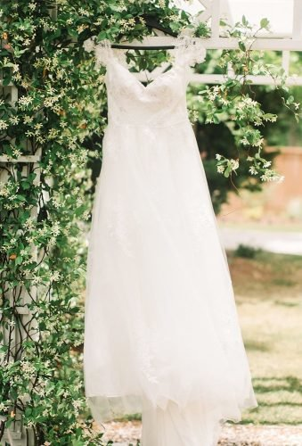 hanging wedding dress dress in greenery amberrhodesphotography
