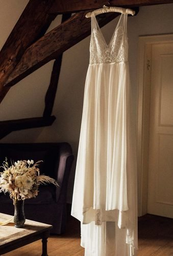 hanging wedding dress hangin dress and bouquet melliandshayne