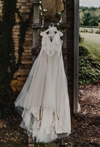 hanging wedding dress outdoor hanging dress izzylambertphoto
