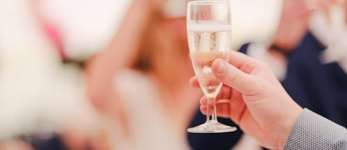how to write a wedding toast glass of champagne wedding toast featured