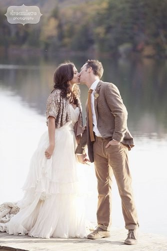 fall wedding party glittery wedding jacket bride and groom kissin