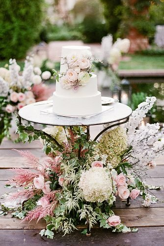 outdoor wedding ideas cake table with floral decor