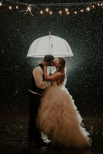 slow dance songs bride and groom kissing under the rain