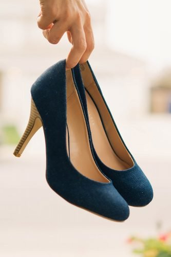 wedding trends woman holding denim shoes