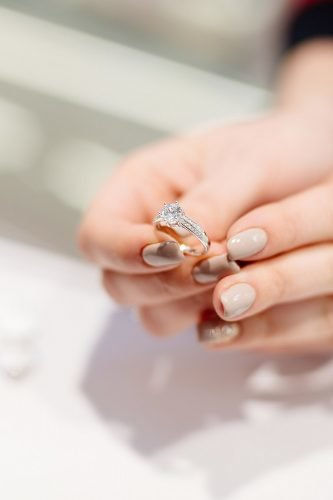 wedding trends woman holding diamond ring