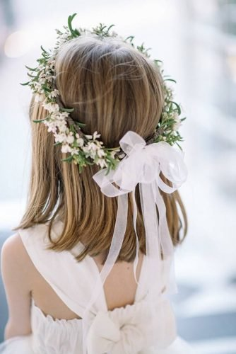 flower girl hairstyles with white flowers and greenery crown and sean money elizabeth fay