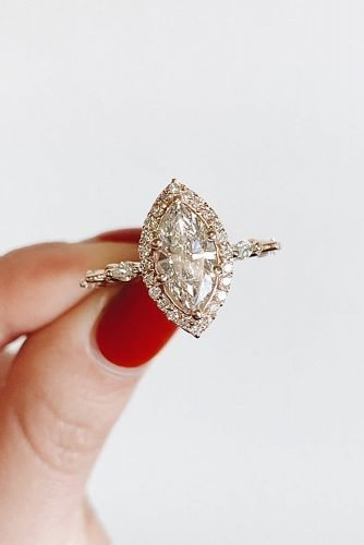 halo engagement rings marquise cut diamond gold