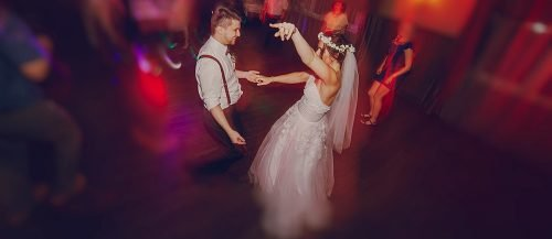 upbeat wedding songs newlyweds dancing on the danceflooor featured