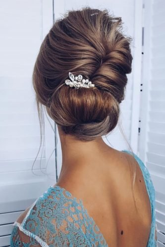 wedding updos elegant swept low bun with pearly pin ksenya_makeup