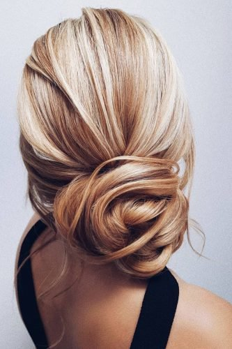 wedding updos low elegant textured bun on blonde hair hairbyhannahtaylor