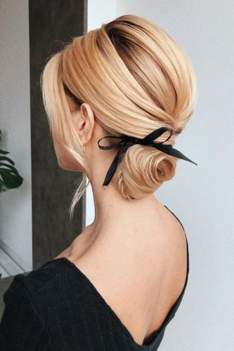 wedding updos low swept updo with black ribbon bow i_pasechnik