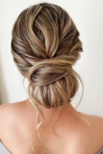 wedding updos messy low chignon with loose curls pearly.hairstylist