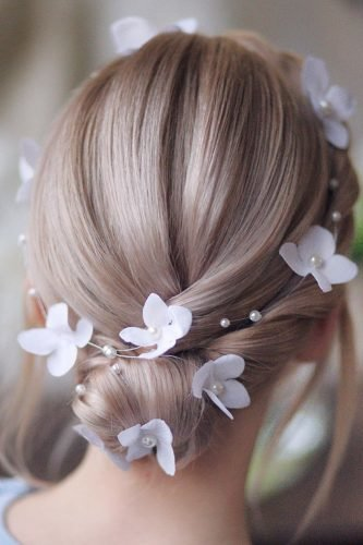 wedding updos simple low bun with flower halo hair_vera