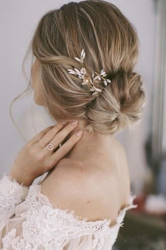 wedding updos slightly messy with low bun and elegant hairpin ulyana.aster