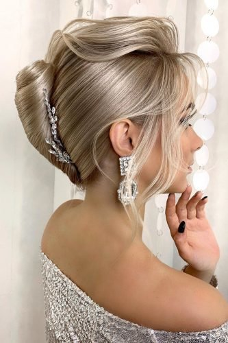 wedding updos smooth french roll on blonde hair with loose curls nadigerber