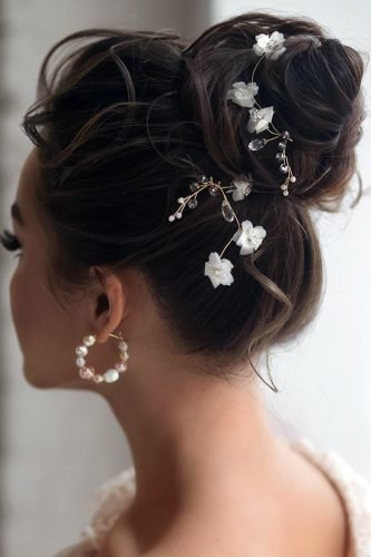 wedding updos textured high ballet bun on dark hair with accessories hair_vera