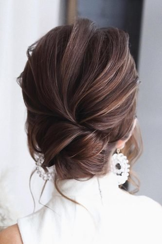 wedding updos textured low bun on dark hair tonyastylist