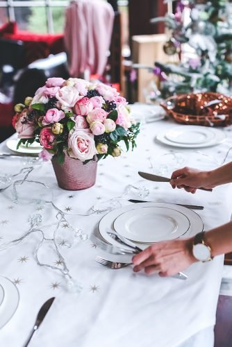 average cost of wedding venues woman preparing wedding table