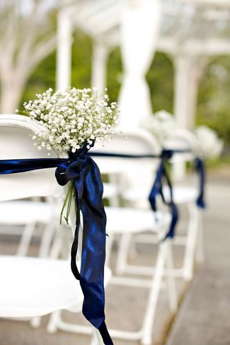classic-blue-wedding-baby-breath-and-stripes-on-chairs-ann-wade-parrish-photography