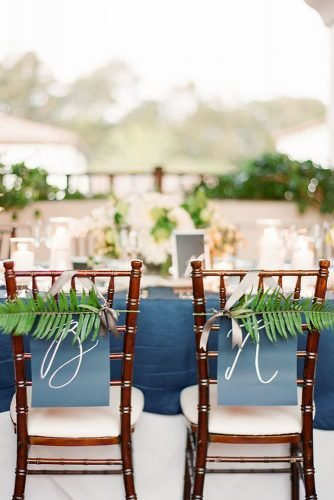 classic blue wedding blue signs and greenery on chairs decor ktmerry