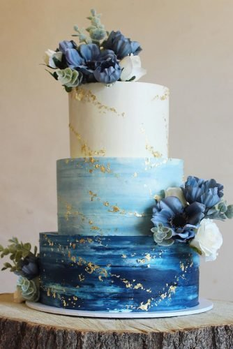 classic blue wedding blue white ombre with flowers and golden foil beth_haxby_cakes
