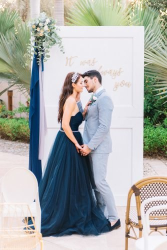 classic blue wedding ceremony altar old door couple with flowers and cloth decor liz jvr photography