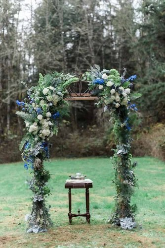 classic blue wedding elegant bridal altar with greenery hope helmuth photography