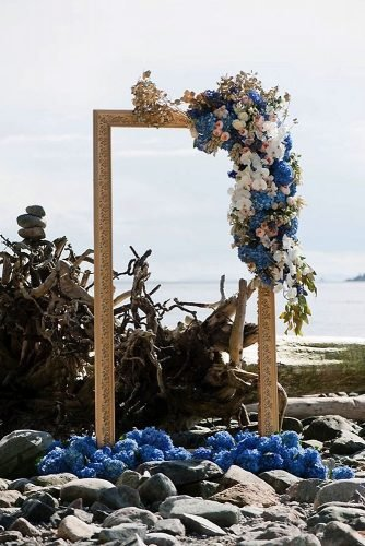 classic blue wedding elegant bridal artar on the beach gold frame with flowers jasalyn thorne photographers