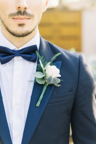 classic blue wedding groom suit with blue bow tie boutonniere with white flower liz jvr photography