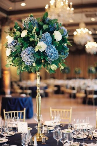 classic blue wedding simple flower centerpiece in tall gold stand kristin la voie photography