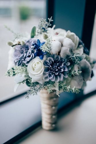 classic blue wedding small bouquets with dahlias and cotton flowers surrey wedding photographer