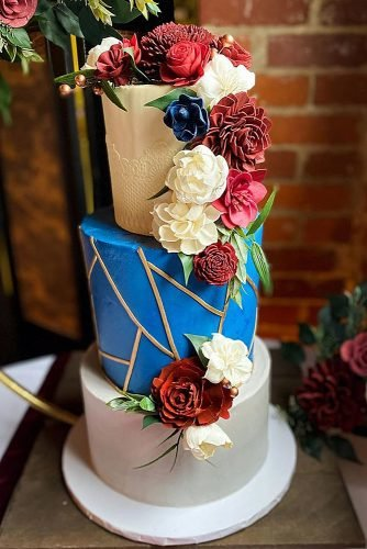 fall wedding cakes colored three layer cake with flowers