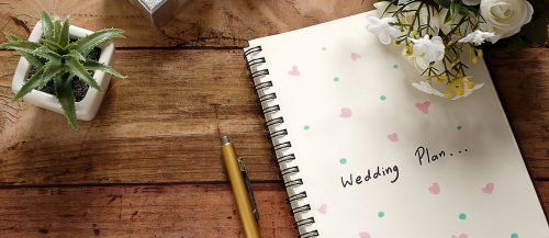 planning a quick wedding notebook desk plan featured