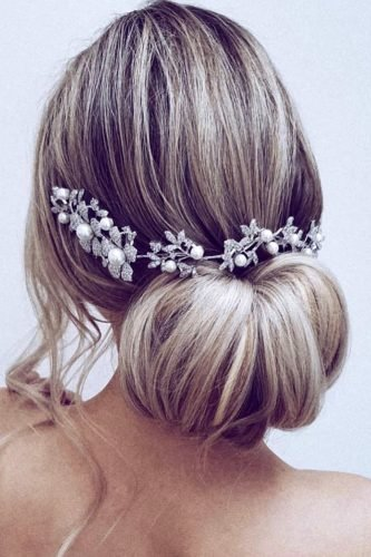 wedding hair trends elegant smooth low bun tiara with crystals and pearls ulyana aster