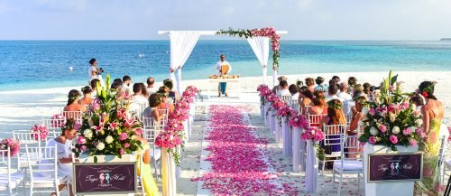 wedding prelude songs beach wedding ceremony during daytime featured