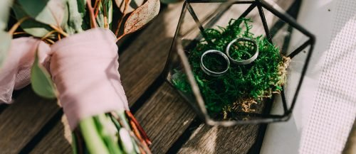 average price of wedding ring rings near a bouquet featured