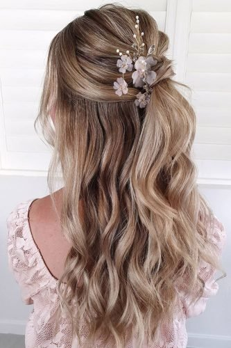 bridesmaid hairstyles half up half down with ponytail and flowers cathughesxo