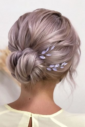 bridesmaid hairstyles low bun with trendy accessory xenia_stylist