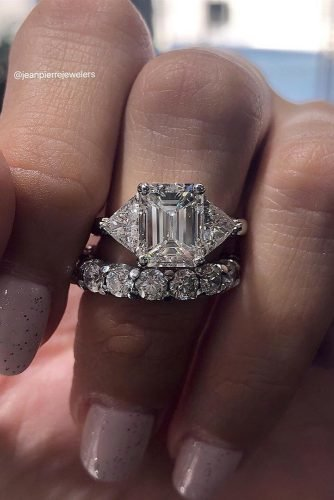 emerald cut engagement rings set three stones