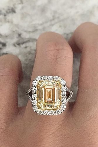emerald cut engagement rings yellow diamond halo