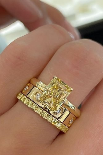 emerald cut engagement rings yellow diamond set